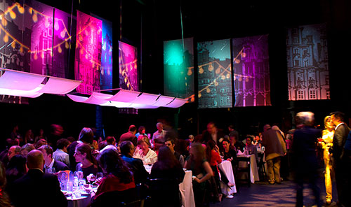 Caravale 2013 event photo of theater stage illuminated by colored lights and custom gobo string lights