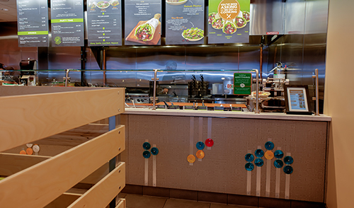Garbanzo Mediterranean Grill front counter applied art