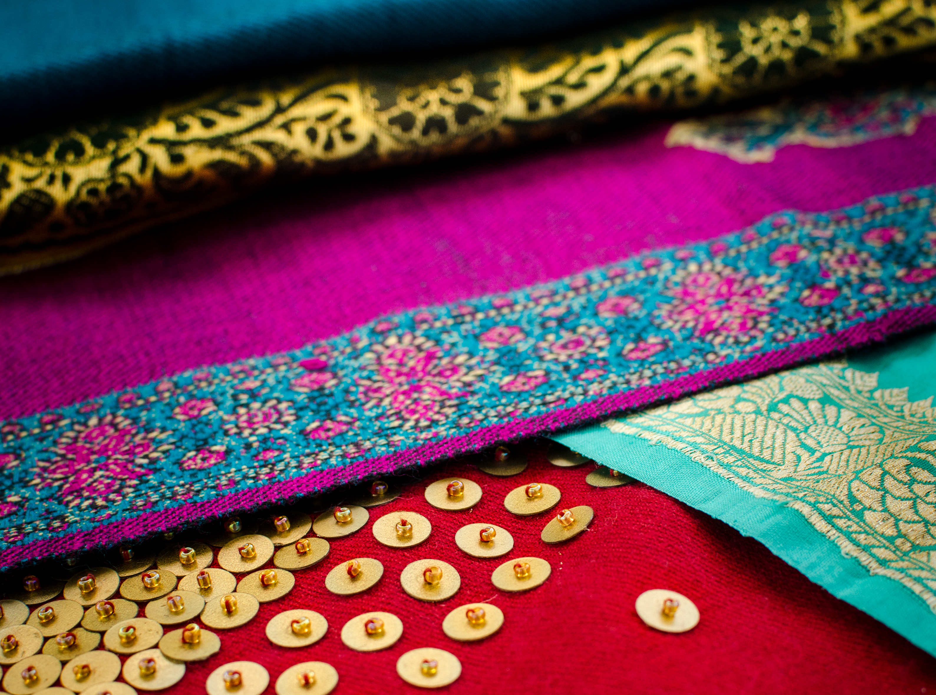 Original photography of colorful Indian sari fabrics for use on Caravale event collateral and presentations