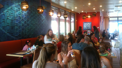 Rubio's Carlsbad restaurant photo showing recycled cardboard lighting and School of Fish mural